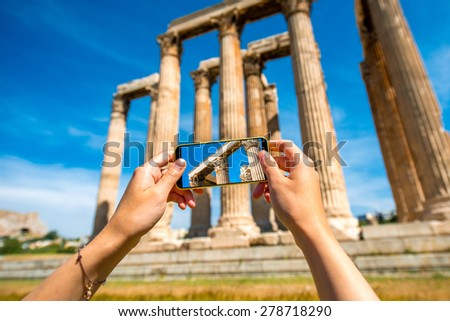 Photographing Zeus temple ruins with mobile phone - stock photo