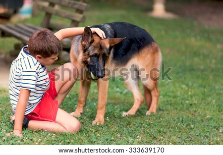 Photographs of a child playing with a ball and your dog