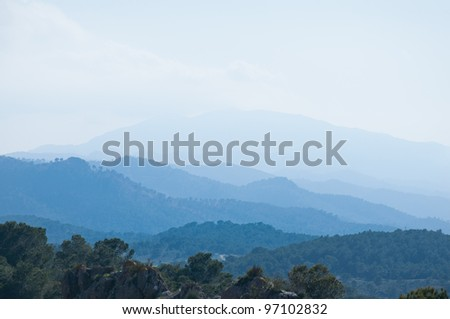 Photographs of a group of mountains in the background with bluish appearance located in Murcia (Spain)
