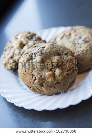 Photographs of three chocolate chip cookies - stock photo