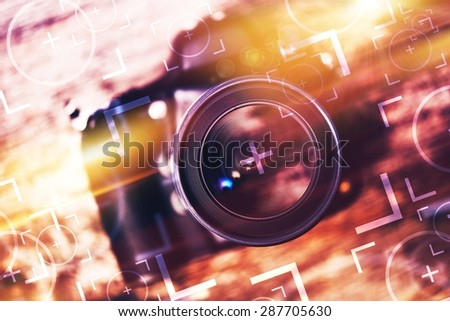 Photography Camera Lens Glass Closeup. Modern Camera on the Old Wooden Table with Concept Photo Elements. Photography Concept. - stock photo