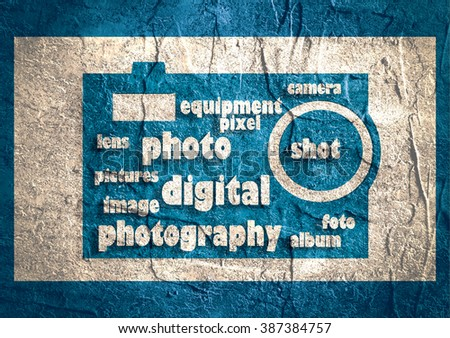 Photography info-text (cloud word) composed in the shape of a generic camera.Concrete textured background. Digital device icon