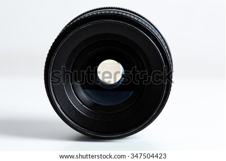 Photography lens on white surface - no branding