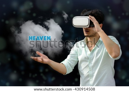 Photography of a man with a Virtual reality. Touching: Heaven - VR - stock photo