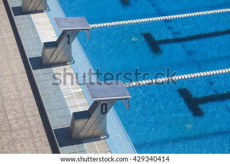 Photography of lanes of a competition swimming pool with water