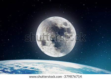 Photography of nightly sky with large moon and stars and earth on the background. Elements of earth on this image furnished by NASA.  - stock photo