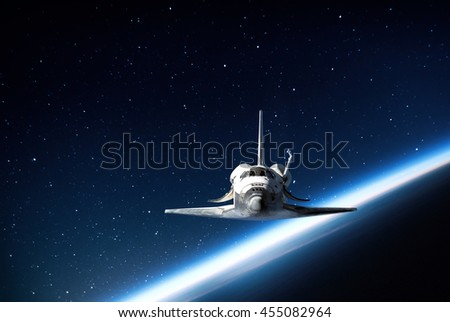 Photography of nightly sky with large moon and stars. Elements of earth and shuttle on this image furnished by NASA.  - stock photo