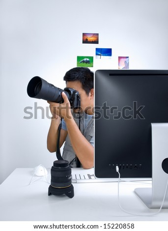 Photojournalist at desk