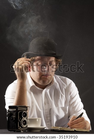 Photojournalist in bowler hat sitting at table smoking, writing. The image is in 1950's style