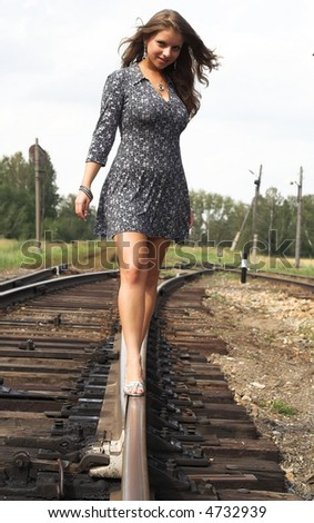 Photos about the girl and the railway