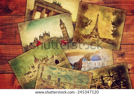Photos from holidays, vacation lying on wooden table. Memories, travel, famous places. Retro vintage style - stock photo