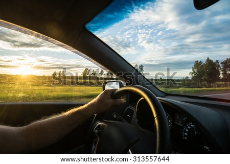Photos from the car in motion. Sunset. - stock photo