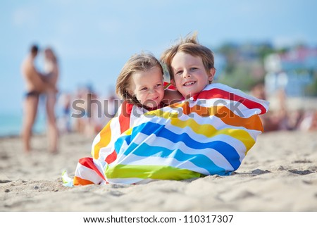 Photos happy kids in the summer on the sand