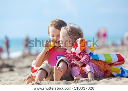 Photos happy kids in the summer on the sand - stock photo