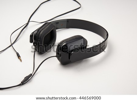 photos of black headphones on a white background