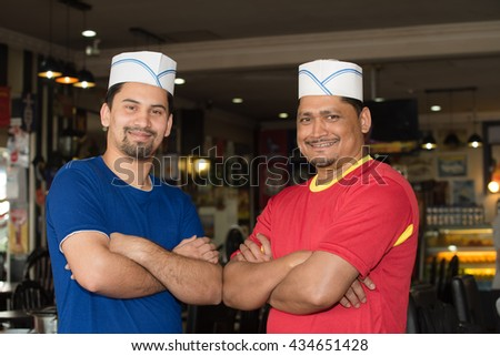 Photos of cooks-chefs in one of the cozy cafes of the town of Tanah Rata, town of Cameron Highlands - stock photo