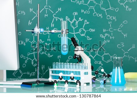 Photos of scientists working place in research laboratory - stock photo