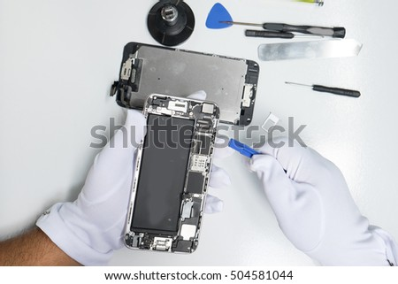 photos showing process of mobile phone repair.