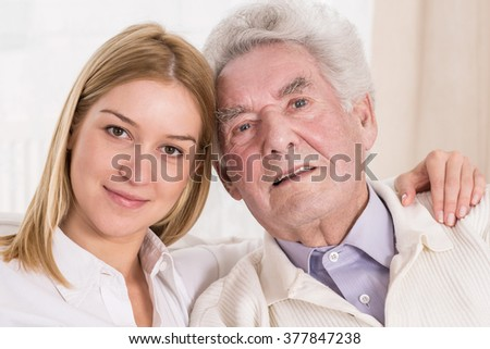 Photoshoot of young smiling woman with old man