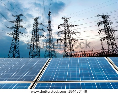 photovoltaic cells and high voltage post. - stock photo