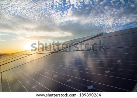 Photovoltaic cells on the background of beautiful cloudes - stock photo