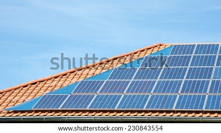 Photovoltaic energy with solar panels on  the roof - stock photo