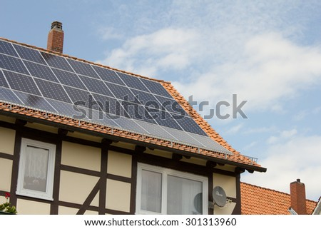 Photovoltaic installation on a dwelling house - stock photo
