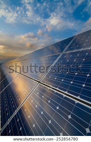 Photovoltaic modules on the background of cloudy sky - stock photo