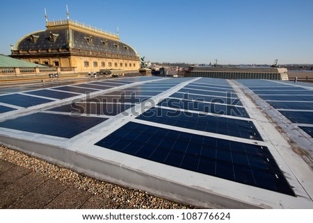 Photovoltaic panels on historical building - stock photo