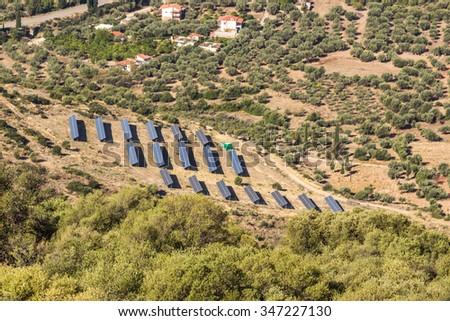 Photovoltaic panels solar field on Greece. - stock photo