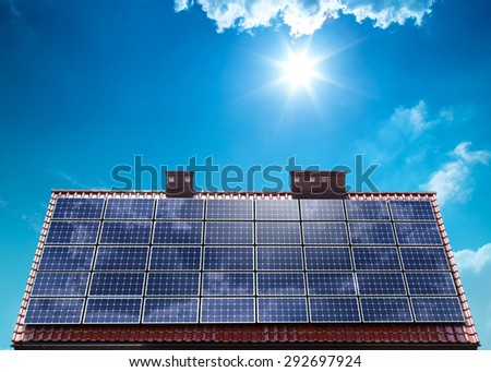 Photovoltaic PV panels on house roof - Photovoltaics (PV) is the name of a method of ecological converting solar energy into direct current electricity - stock photo