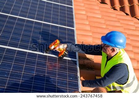 photovoltaic senior worker - stock photo