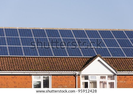 Photovoltaic solar energy panels on the roof of a building. - stock photo