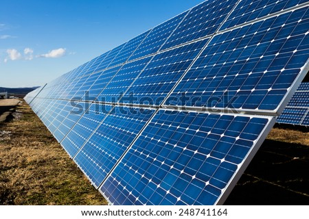 Photovoltaic solar panels in the field - stock photo