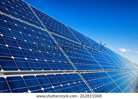 Photovoltaic solar panels installation and sky - stock photo