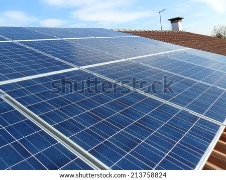Photovoltaic system on a roof's house  - stock photo