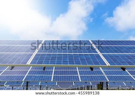 Photovoltaics module solar panel on blue sky background - stock photo