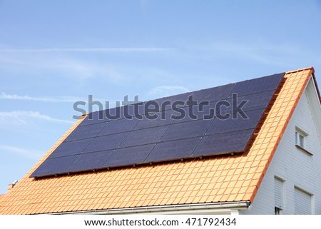 Photovoltaics on the roof of a residential building for alternative energy production