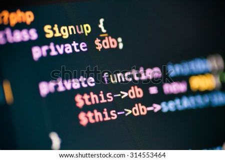 PHP code lines on a monitor - stock photo