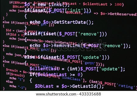 PHP code on black screen, red text. Abstract software development (source code) - stock photo
