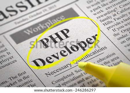 PHP Developer Vacancy in Newspaper. Job Seeking Concept.