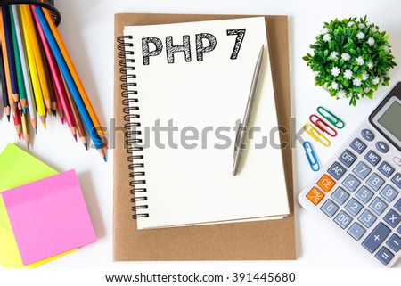 PHP 7 text message on white paper and office supplies, pen, paper note, on white desk , copy space / business concept / view from above, top view - stock photo