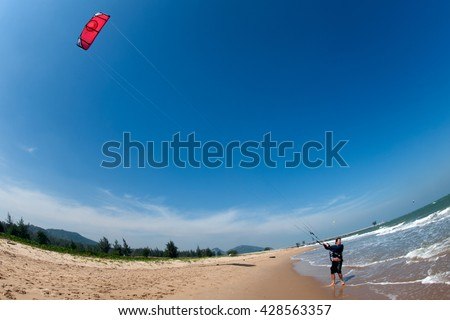 PHRACHUAP KHIRI KHUN, THAILAND - DEC 20, 2016: Phranburi Beach landscape - focused on kite - extreme sport and adventure much practiced in the days of strong summer winds in the Gulf of Thailand sea.