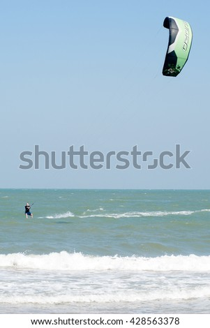 PHRACHUAP KHIRI KHUN, THAILAND - DEC 20, 2016: Phranburi Beach landscape - focused on kite - extreme sport and adventure much practiced in the days of strong summer winds in the Gulf of Thailand sea.  - stock photo