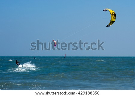 PHRACHUAP KHIRI KHUN,THAILAND-DECEMBER 20,2013 : Unidentified Kite Surfer during a practice of Kite surf  in the sea near Phranburi District.Phrachuap Khiri Khun Province in Middle of Thailand. - stock photo