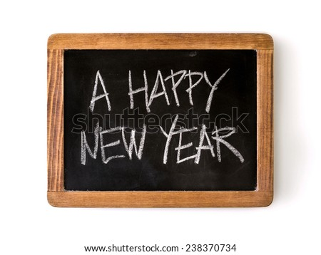 Phrase 'A happy New Year' written with chalk on a blackboard. - stock photo