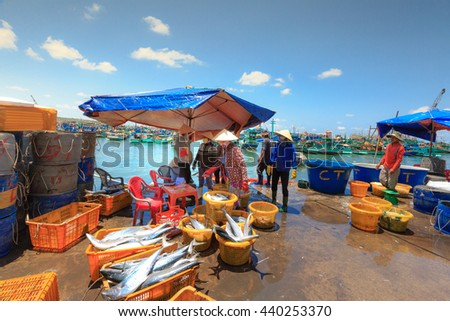 Phu Quoc island, Kien Giang province, Vietnam - May 02, 2016: People's daily life at the fishing village on Phu Quoc island, they collecting fresh fishes from boat and open up a market in the early
