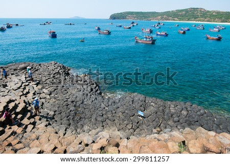 PHU YEN, VIETNAM, June 12, 2015. Fishers on boats in the sea near Ganh Da Dia. Ganh Da Dia is a famous travel place in middle of Vietnam.