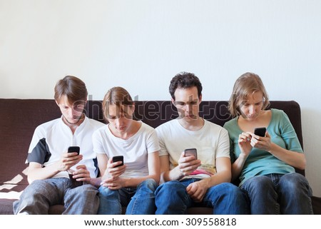 phubbing,internet addiction, group of young people looking at their smart phones - stock photo