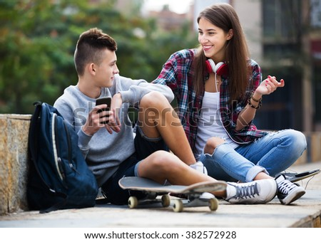Phubbing: teenager boy and girl asking for attention